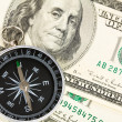 Compass and dollar - Stock Photo