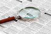 Classified Ad and magnifying glass — Photo