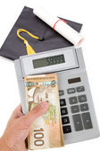 Black Mortarboard and canadian dollar — Stock Photo