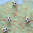 Stock Photo: Soccer balls on the map of Poland