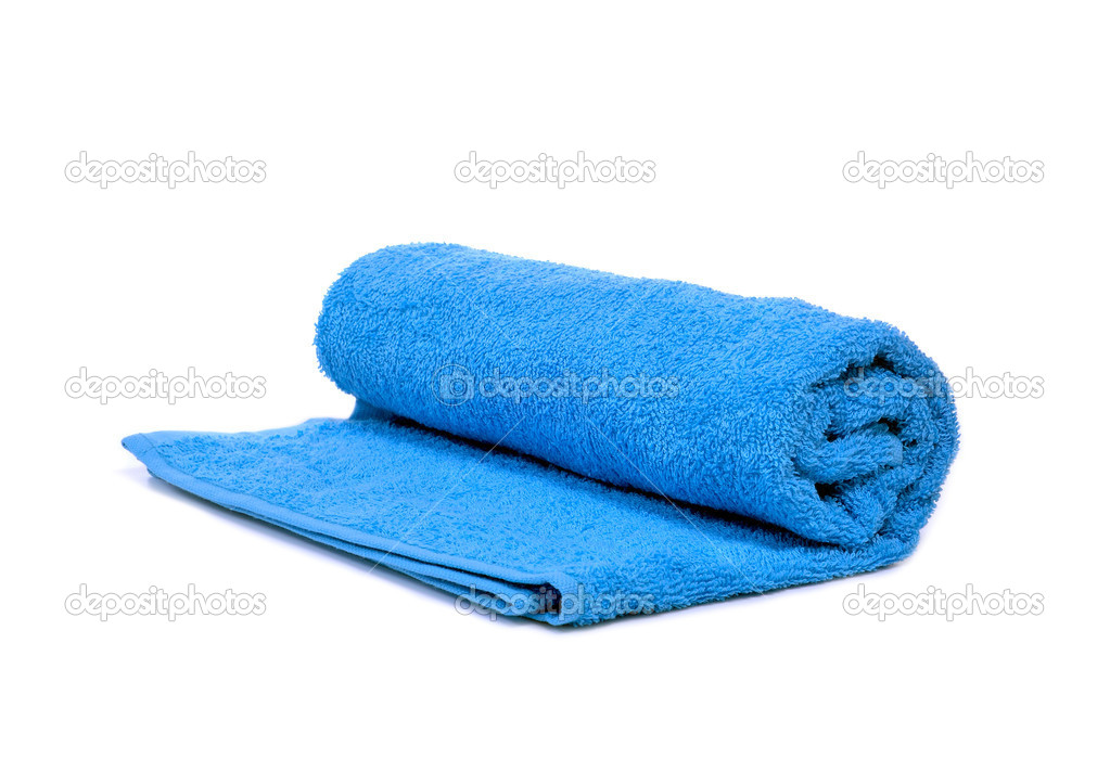 A blue towel rolled up on a white background — Stock Photo #11332280