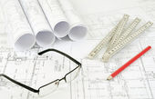 Construction plans and glasses — Stock Photo