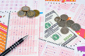Lottery tickets and money — Stock Photo