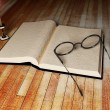 Stock Photo: Book, glasses and a candle