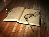 书、 眼镜和一根蜡烛 — 图库照片