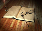 Livro, óculos e uma vela — Foto Stock