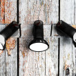 Three lamps on the wooden wall — Stock Photo