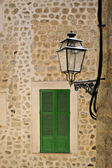 Typical mediterranean window and stret lamp — Stock Photo