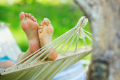 Hammock and woman feet — Stock Photo