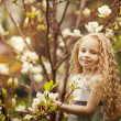 Beautiful girl and blooming magnolia tree — Stock Photo #11983449