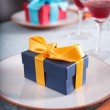 Couple of gifts at restaurant — Stock Photo