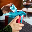 Royalty-Free Stock Photo: Opening a blue bow gift
