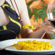 Woman eating spanish paella — Stock Photo #11479035