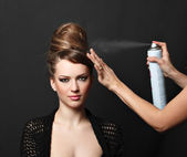 Hair spray, woman over black — Stock Photo
