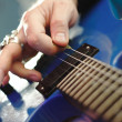 Rockstar playing solo on guitar. — Stock Photo