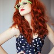Fashion portrait of red haired girl. — Stock Photo