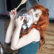 Beautiful housewife licking a pot cover — Stock Photo #10956834