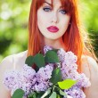 Beautiful girl with flowers — Foto de stock #10956879