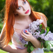 Beautiful girl with flowers — Stock fotografie