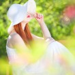 Mysterious girl in a garden — Stock Photo