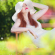Attractive woman relaxing in a garden — Stock Photo