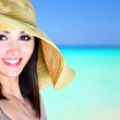 Beautiful girl on a tropical beach — Stock Photo #10957185