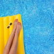 Woman relaxing in a pool - feet close up — Stock Photo #10957470