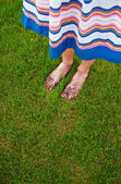 Muddy feet with red nails - gardening concept — Stock Photo
