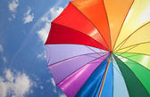 Rainbow umbrella on sky background — Stock Photo