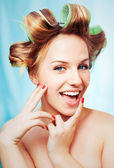 Young beauty woman with hair-rollers — Stock Photo