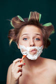 Girl shaving face — Stock Photo