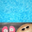 Foto de Stock  : Holiday concept, flip flops pool