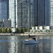A sailboat and modern buildings in Vancouver BC canada. — Stock Photo
