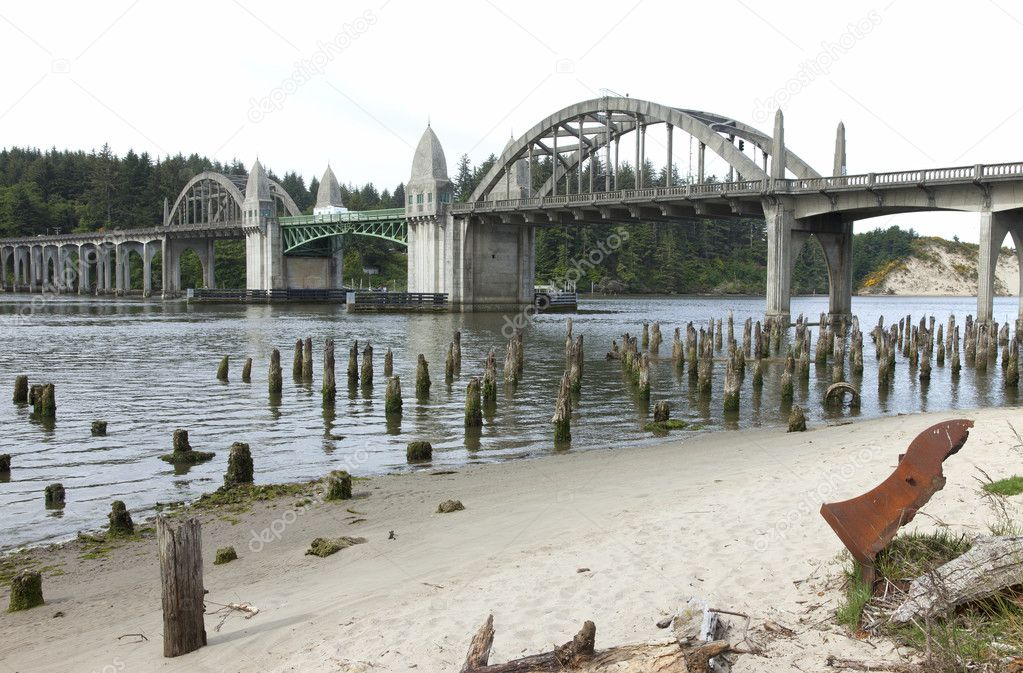 Bridge crossings and river with tree stumps, Florence OR. — Stock Photo #11345779