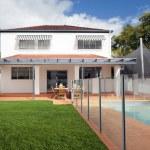 Modern backyard with pool — Stock Photo #11237290