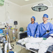 Постер, плакат: Surgery room with surgeon and nurses