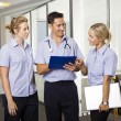 Young doctor with two nurses — Stock Photo