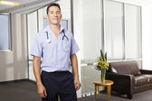 Young doctor in hospital waiting room — Stock Photo