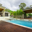 Stock Photo: Modern backyard with pool