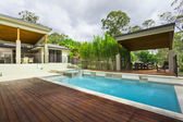 Modern backyard with pool — Stock Photo