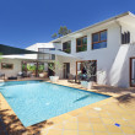 Backyard with swimming pool — Stock Photo #11636543
