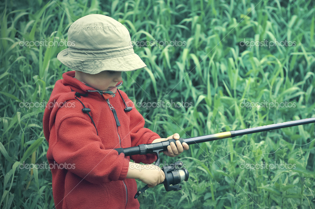 Little boy holding fishing rod stock photo przemekklos for Little boy fishing