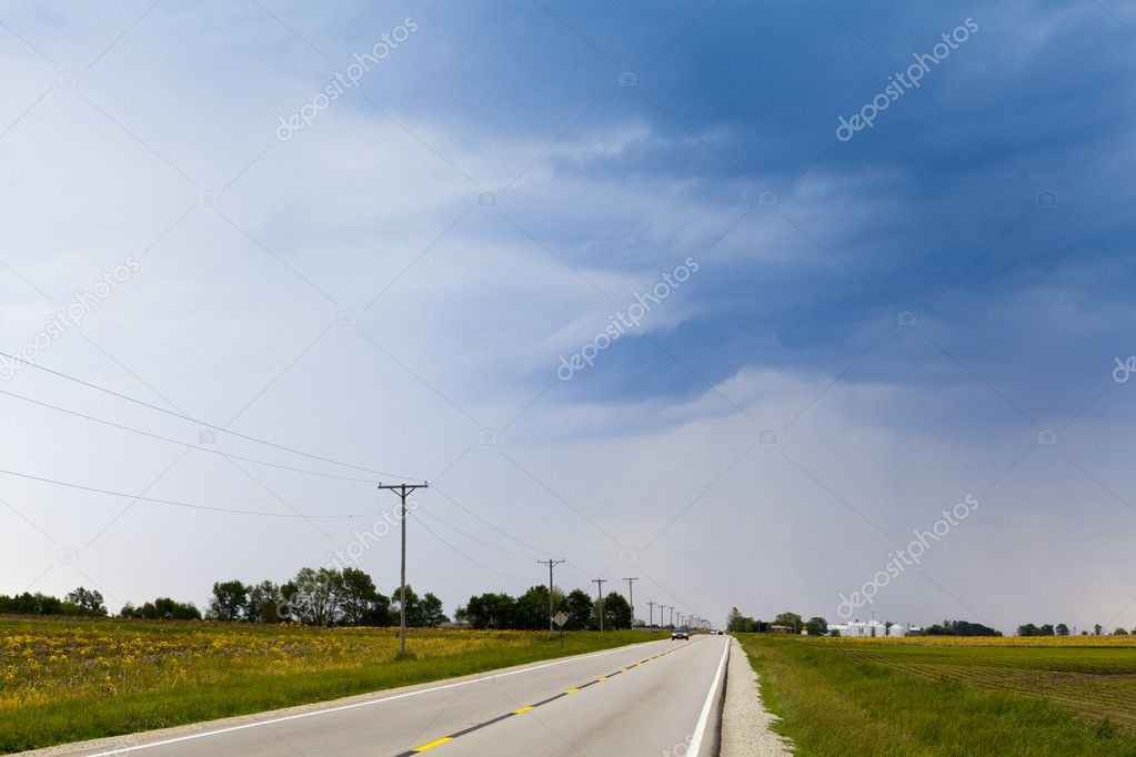 Country Road with stormy sky  Stock Photo #10768269