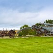 Old rusty tractor with wind turbines in the background. — Stock Photo #11381839