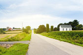 Country Road With Red Farm and Church — Stock Photo