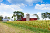 Field with Farm Buildings in the background — Stock Photo