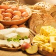 Stock Photo: Dairy food, eggs, breads, cheese and apples