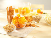 Salty snacks. Pretzels, chips, peanuts, crackers, popcorn — Stock Photo