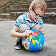Stock Photo: Time for school. Kid with globe.