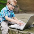 Happy boy with laptop - Stock Photo